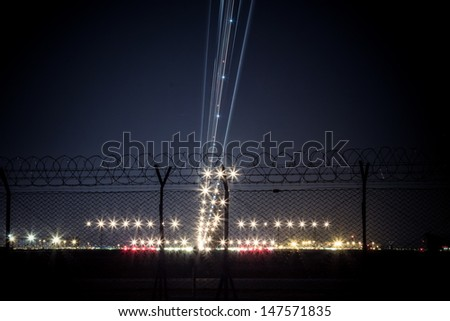 light trail of aircraft while landing - stock photo