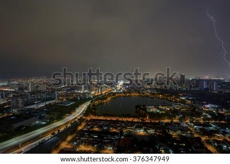 Light trails  and Lightning strikes over Kuala Lumpur city skyline at night - stock photo
