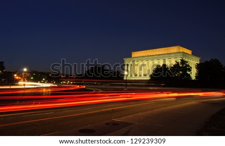 Light trails at dusk near Lincoln Memorial, National Mall. Washington, DC - stock photo