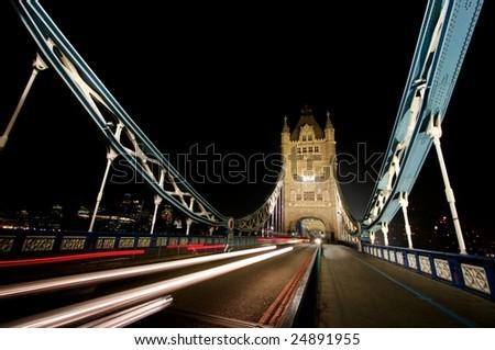 Light trails at night across Tower Bridge, London - stock photo