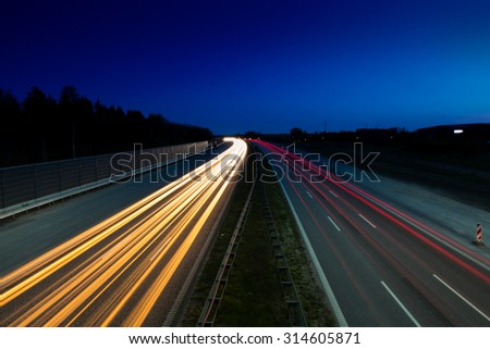 Light trails from car on highway. traffic, travel, time, concept and themes