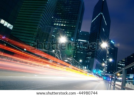 Light trails from cars travelling down - stock photo