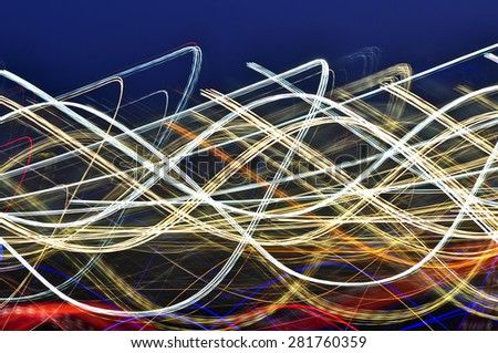 Light trails in airport. - stock photo