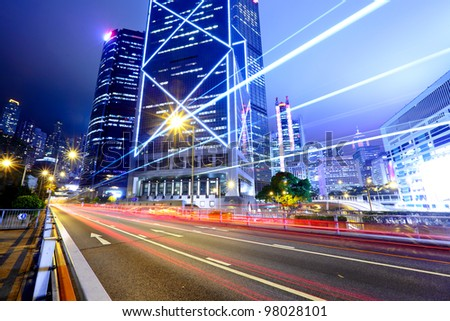 light trails in city at night - stock photo