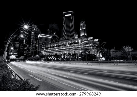 Light trails in the financial district of Singapore - stock photo