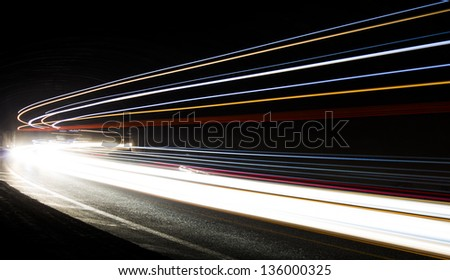 light trails in the tunnel. Art image . Long exposure photo taken in a tunnel