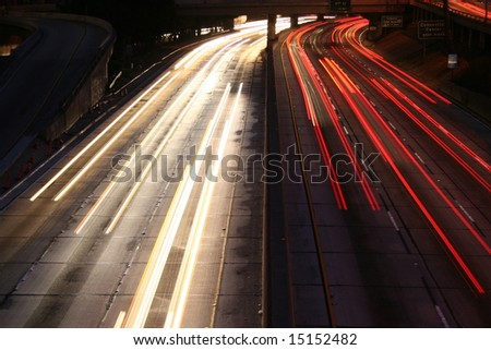 Light Trails Los Angeles Freeway at Night - stock photo