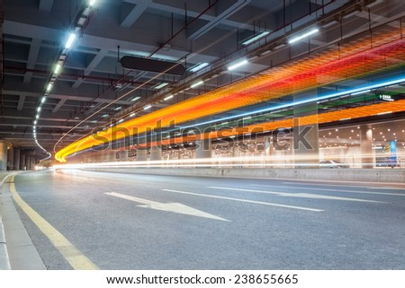 light trails of vehicles in the tunnel   ,futuristic city road background  - stock photo