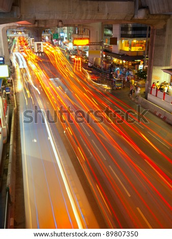 Light trails on a center street in Bangkok - stock photo