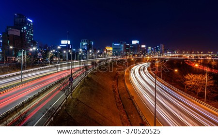 Light trails on a highway at night - stock photo