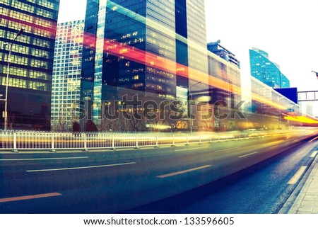light trails on the modern city at dusk in beijing,China - stock photo