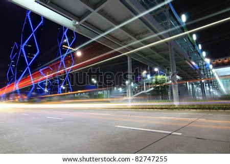 light trails on the modern city street at night - stock photo