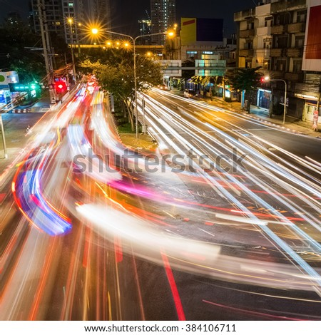 light trails on the road at night, bangkok , thailand.