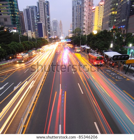 Light trails on the road in the city now - stock photo