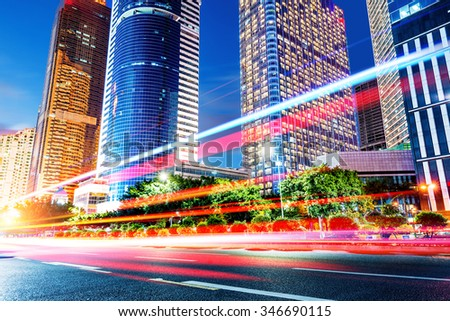 light trails on the street at dusk in guangdong,China - stock photo