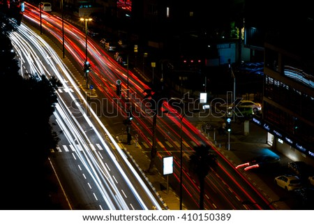 light trails on the street at night city - stock photo