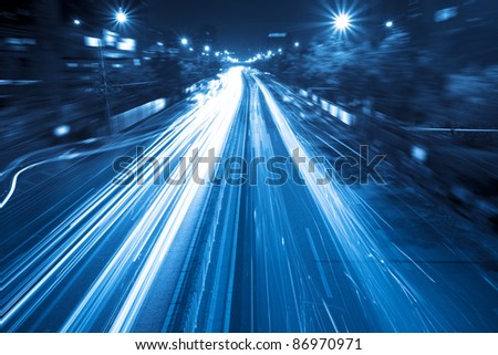 light trails on the street in rush hour traffic at night - stock photo