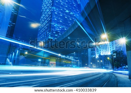 light trails through the footbridge,hongkong china.