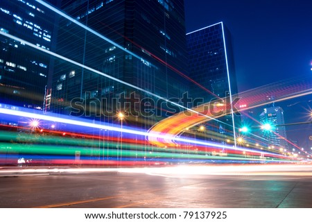 light trails with blurred colors on the street at night - stock photo