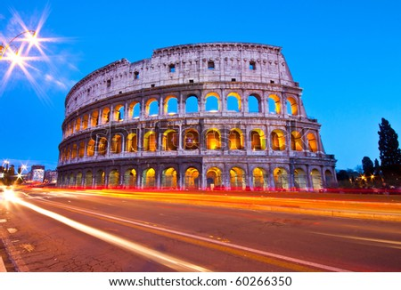 Light trials in front of colosseum in dusk - stock photo