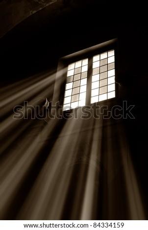 light trough the window of the church - stock photo