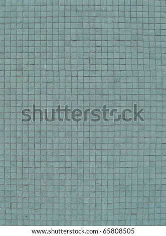 light turquoise blue mosaic tiles on a wall - stock photo