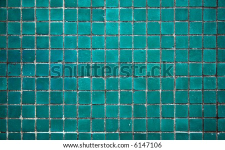Light turquoise tile of the bathroom wall