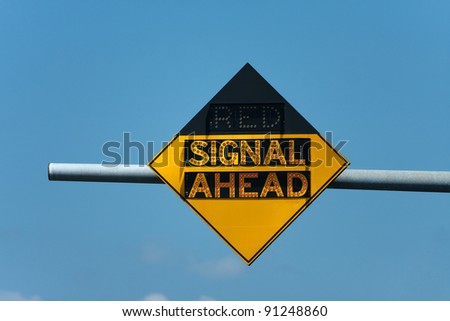 Light up roadway sign that tells when there is a red traffic signal ahead. - stock photo
