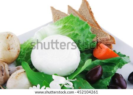 light white feta cheese and green lettuce on white - stock photo