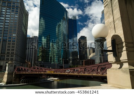 Light with downtown and reflections off of buildings in background.  Chicago, Illinois, U.S.A.. - stock photo