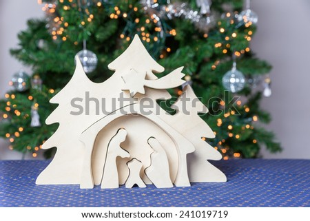 Light wooden christmas crib with Joseph and Mary - stock photo