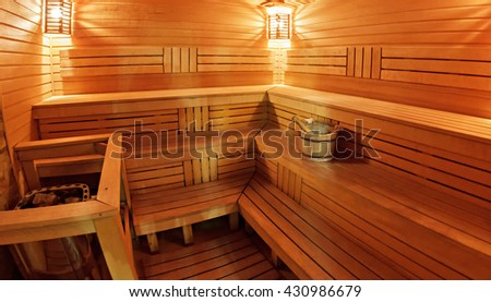 Light wooden sauna with bench  - stock photo