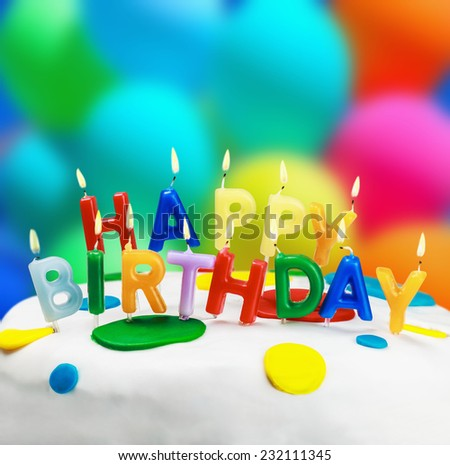 lighted candles on a birthday cake - stock photo