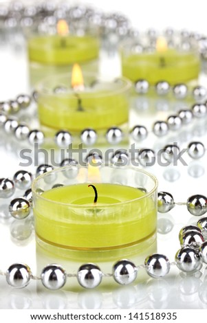 Lighted candles with beads close up