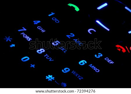Lighted cell phone keypad - stock photo