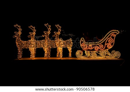 Lighted Christmas sleigh in Advent - stock photo