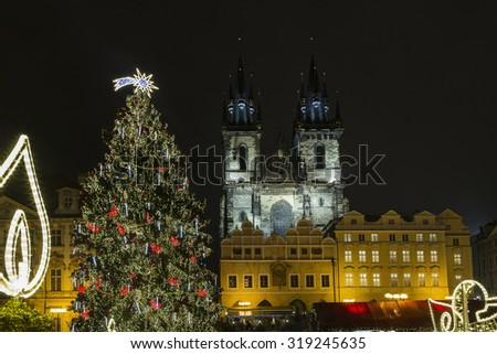 Lighted Christmas tree on the Old Town Square in Prague. Old Town Square at Christmas time, Prague, Czech Republic. - stock photo