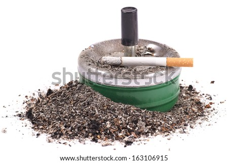 Lighted cigarette with a filter on the ashtray and ashes