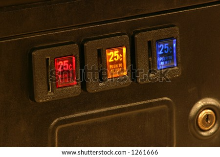 Lighted coin slots of an arcade game machine - stock photo