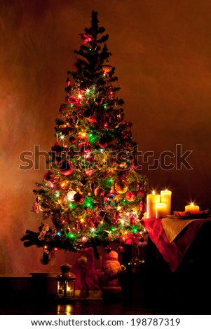 Lighted decorated Christmas tree in living room - stock photo
