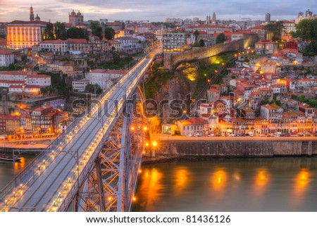 Lighted  famous bridge Ponte dom Luis above  Old town Porto at river Duoro at night, Portugal