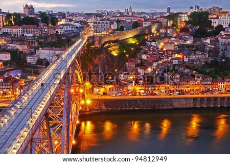 Lighted  famous bridge Ponte dom Luis above  Old town Porto at river Duoro at night, Portugal - stock photo