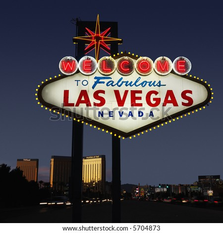 Lighted Las Vegas, Nevada welcome sign with night sky. - stock photo