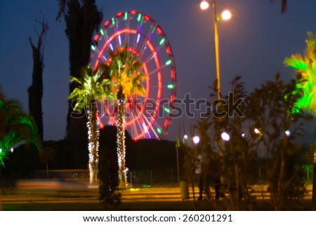 Lighted palm trees and illumination on  street South of the city.  entertainment industry - stock photo