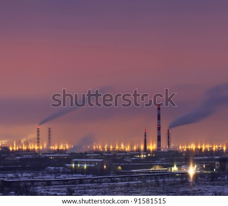 Lighted refinery  in the evening after sunset - stock photo