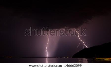 lightening bolt at the sea - stock photo