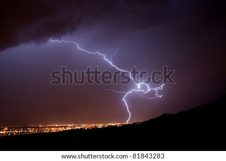 Lightening hitting ground.  Making art in the meantime. - stock photo