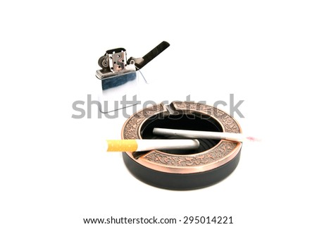 lighter and two cigarettes in the ashtray - stock photo