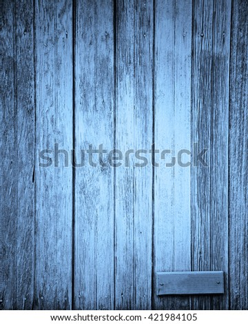 lighter blue plank with small blank sign for text - stock photo
