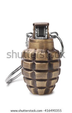 Lighter in the form of a hand grenade on white background - stock photo